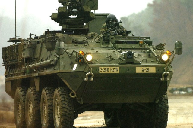 Soldiers in a Stryker vehicle practice their maneuvers.