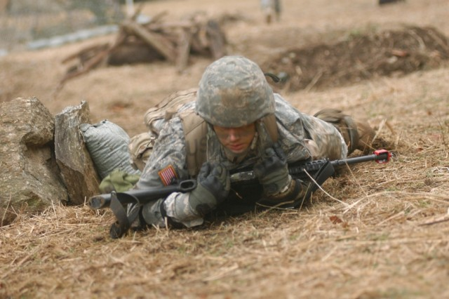 Soldiers conduct individual movement drills the Expert Infantryman's Badge testing at Camp Casey, Korea.