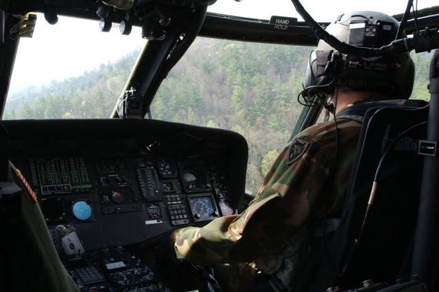 """The UH-60 Black Hawk pilot and crew search the terrain for the """"missing"""" hiker."""