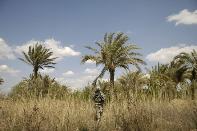 A Soldier watches for IEDs as well as enemy activity.