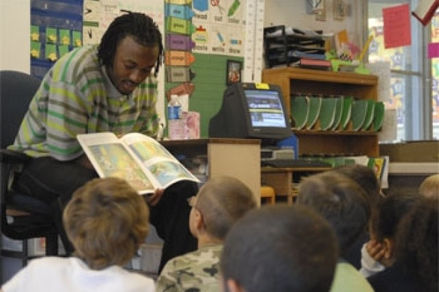 Baltimore Ravens cornerback David Pittman reads to childre at Pershing Hill Elementary School during celebrity guest reader day.