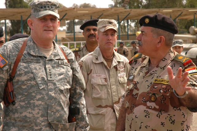 Gen. Schoomaker visits Iraqi Army Maj. Gen. Ayoub Bashar, commander, 9th Iraqi Army Division (IAD) in April 2006 as Col. John Hort, senior advisor to the 9th IAD Military Transition Team, looks on.