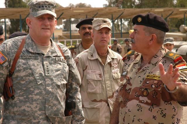 Gen. Schoomaker visits Iraqi Army Maj. Gen. Ayoub Bashar, commander, 9th Iraqi Army Division (IAD) in April 2006 as Col. John Hort, senior advisor to the 9th IAD Military Transition Team, looks on.