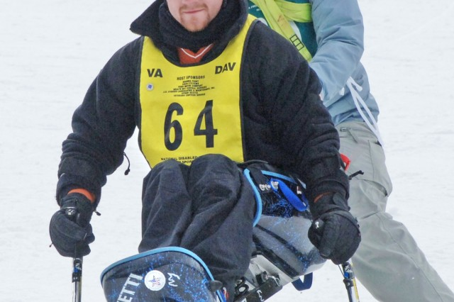Dallas Chambless (front) participates in the 21st National Disabled Veterans Winter Sports Clinic, which began Sunday and ends today in Snowmass Village, Colo.