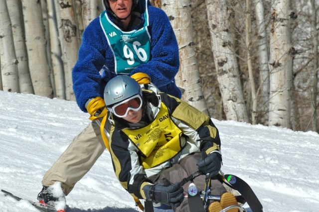 Alan Babin (front) participates in the 21st National Disabled Veterans Winter Sports Clinic, which began Sunday and ends today in Snowmass Village, Colo.