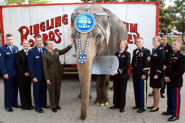 "Nicole, a Ringling Brothers and Barnum and Bailey Circus elephant, officially welcomes members of the Defense Department's ""Why We Serve"" speakers program to Military Appreciation Night the at circus held at George Mason University's Patriot Center, April 4. Defense Dept. photo by Samantha L. Quigley"
