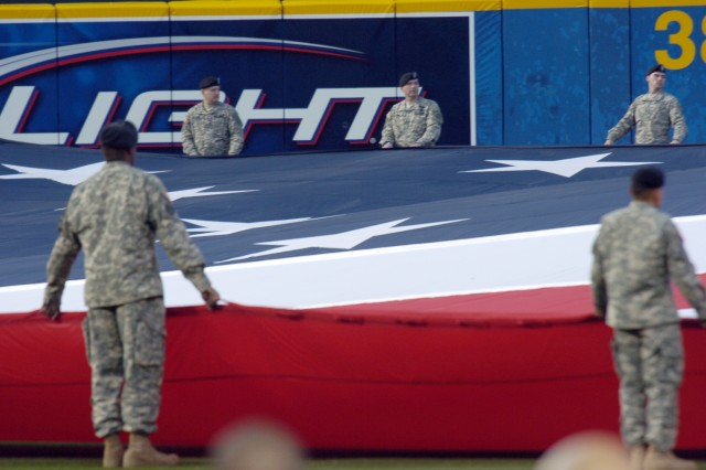 Soldiers from Third Army/U.S. Army Central carrying the flag during the Atlanta Braves opening day ceremony April 6 at Turner Field in Atlanta. Servicemembers from every branch stationed in the Atlanta area assisted in carrying the flag, which  was more than 300 feet long and 100 feet wide.
