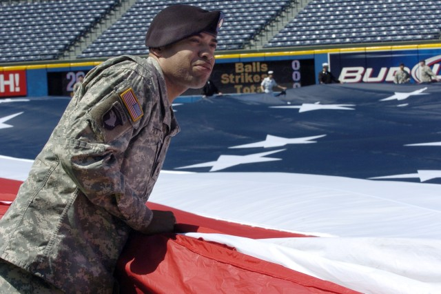 Staff Sgt. Javis I. Pittman, Third Army/U.S. Army Central G-2 Plans NCO, listens to pre-ceremony instructions before the Atlanta Braves opening day ceremony April 6 at Turner Field in Atlanta.