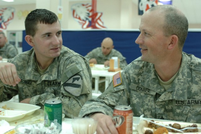Master Sgt. John Conner, an infantryman with the 4th Brigade Combat Team, 25th Infantry Division, eats dinner with his son, Pfc. Jeremy Conner, an infantryman with the 4th Brigade Combat Team, 1st Cavalry Division, at Forward Operating Base Marez, Iraq, April 1.