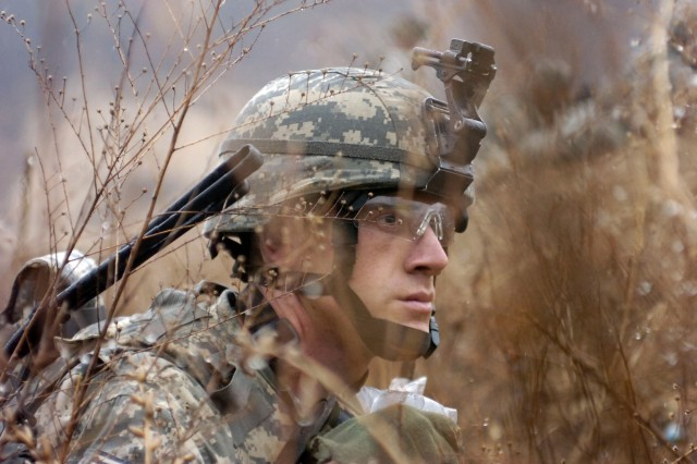 Staff Sgt. Mark O'Neill observes his squad during dismounted maneuvers in Yongpyong.
