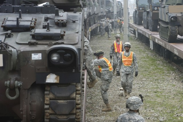 Soldiers prepare to offload M109A6 Paladin self-propelled howitzers arriving by rail at Camp Casey.