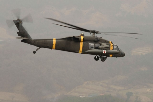 A UH-60 Black Hawk helicopter flies a mission over Seoul.