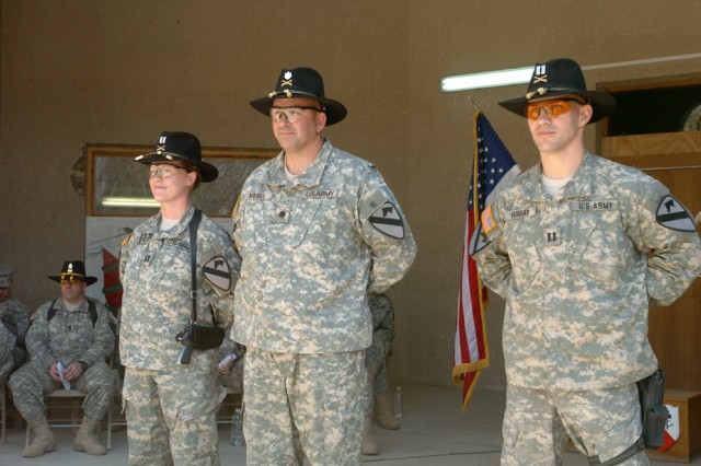 Capt. Teresa Murray, of West Palm Beach, Fla. (left to right), Lt. Col. Jeffrey Vieira, and Capt. Ken Murray, of Baton Rouge, La., stand in front of the company formation prior to Company C, 15th Brigade Support Battalion's change of command ceremony on Forward Operating Base Prosperity, Iraq April 1.