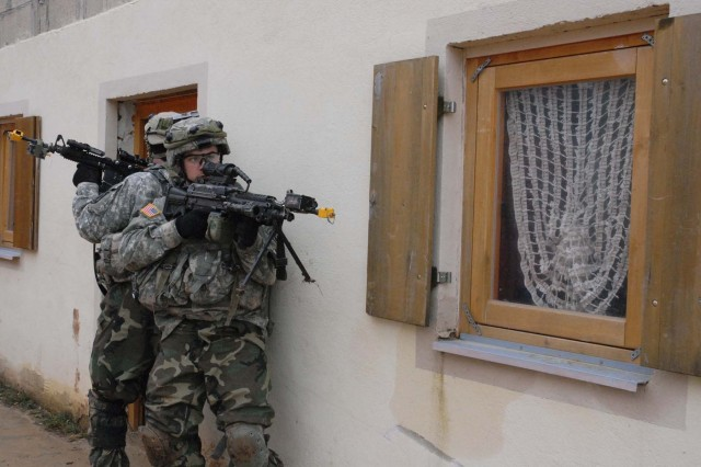 Soldiers get ready to search some homes.