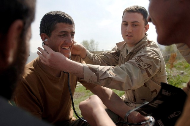Senior Airman Phillip Borde teaches a hands-on training course with Afghan National Army soldiers on how to take vital signs in the field near Kabul, Afghanistan. The soldiers are participating in the Combat Medic Course. Airman Borde is a mentor assigned to the Combat Medic School.