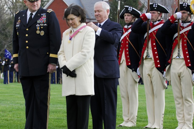 Secretary of Defense Robert M. Gates presents a medal to Mrs. Schoomaker, wife of outgoing Army Chief of Staff Gen. Pete Schoomaker, during the change of responsibility ceremony at Fort Myer, Va., April 10. Gen. George W. Casey Jr. took over as chief of staff from Gen. Schoomaker in a ceremony hosted by Acting Secretary of the Army Pete Geren.