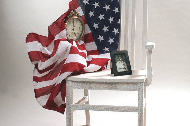 """Ms. Karen Reed of Fort Hood, Texas, won the accomplished artists' mixed media three-dimensional category of the 2006 Army Arts and Crafts Contest with """"Our Father's Chair."""""""