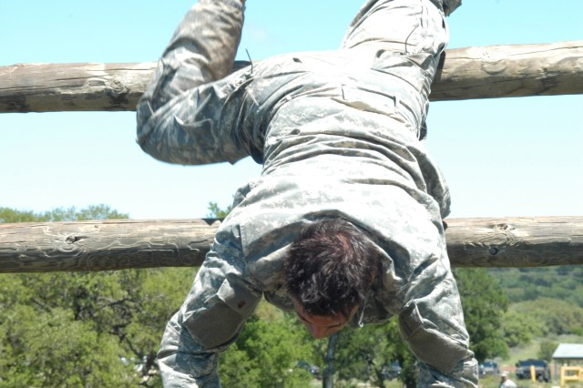 Staff Sgt. Cesar Veliz, 75th Ranger Regiment, descends on the obstacle course portion of the Expert Field Medical Challenge April 13-16 at Camp Bullis and Fort Sam Houston, Texas. Staff Sgt. Veliz finished second in the contest.