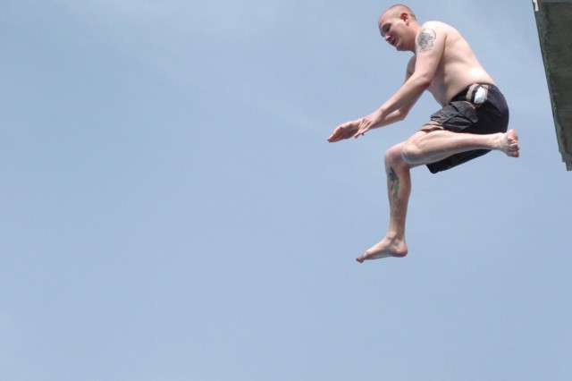 Spc. Dan Medoff, 23, a combat medic with 28th Combat Support Hospital, 44th Medical Command, leaps from the 30-foot high-dive into the pool during the Big Splash competition at Freedom Rest April 10. Freedom Rest is a program for servicemembers deployed in support of Operation Iraqi Freedom, which gives participants the opportunity to enjoy four days of rest and relaxation.