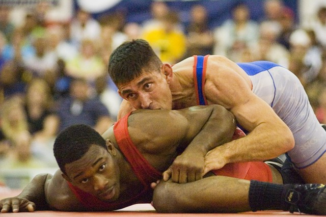 Army World Class Athlete Program Staff Sgt. Keith Sieracki bears down on Gator Wrestling Club's T.C. Dantzler during the 163-pound Greco-Roman finale at the 2007 U.S. National Wrestling Championships April 7 at Las Vegas Convention Center. Dantzler won the match, 2-1, 1-1. Staff Sgt. Sieracki, who took the silver medal, is one of 17 Soldiers who qualified for the U.S. World Team Trials, scheduled for June 9-10 in Las Vegas.