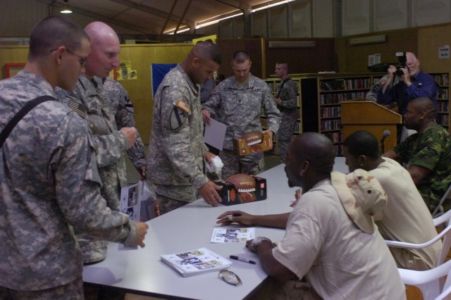 To increase troops' morale, three National Football League players visited with Multinational Division - Baghdad Soldiers at the Liberty Morale Welfare and Recreation building April 16.