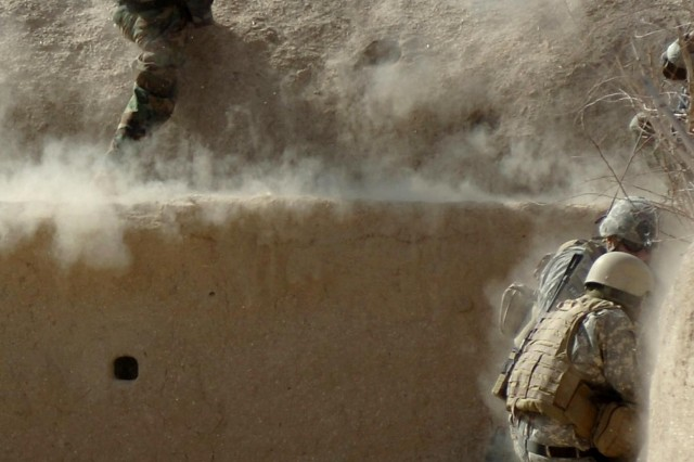 An Afghan National Army Soldier shakes a fighting position with his rocket propelled grenade launcher April 10, during a firefight with extremists in the Sangin District of Helmand Province in southern Afghanistan.
