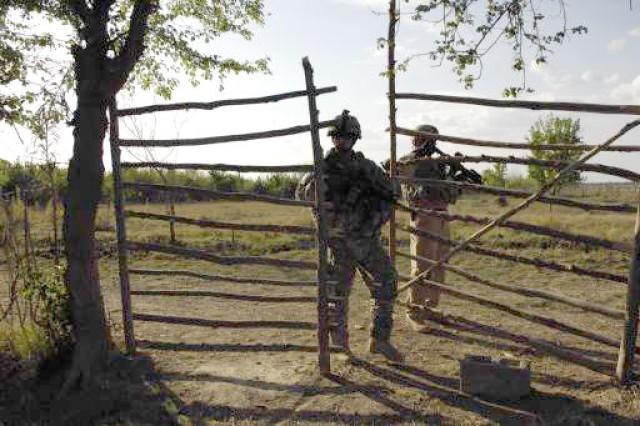 Soldiers enter a farm.