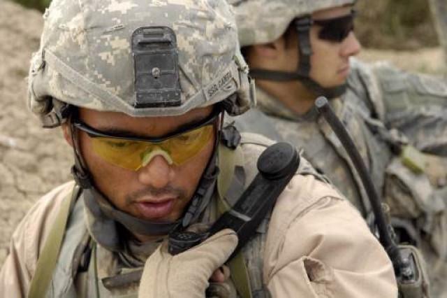 Staff Sgt. Raul Cantu radios his position.