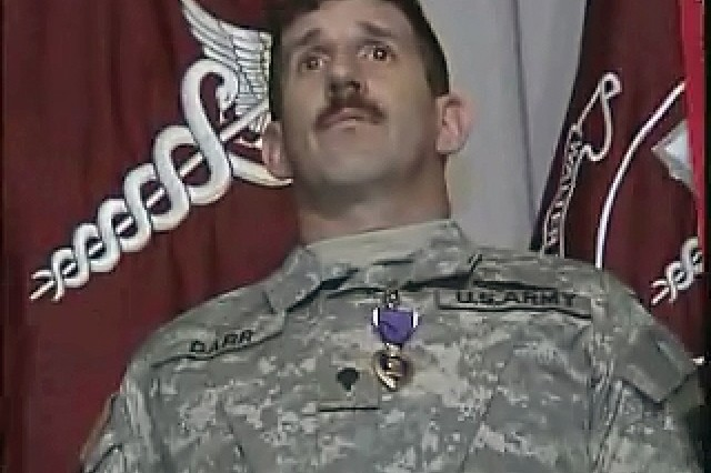 Wounded Warriors receive their Purple Heart awards.