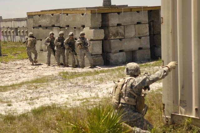 Soldiers practice urban warfare tactics.