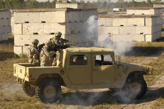 Soldiers encounter simulated rocket-propelled grenade fire in a mock hostile area.