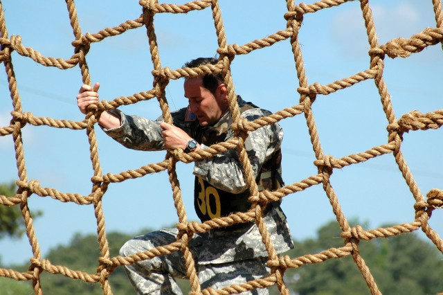 FORT BENNING, Ga., April 20, 2007 -- Maj. Kirk Liddle, 11th Infantry Regiment, climbs a 60 ft. high rope net during the 2007 Lt. Gen. David E. Grange Best Ranger Competition.  The Vancouver, Wash., native and his partner Capt. Ryan Armstrong, of Columbia, Md., are among 39 Ranger teams competing in the three-day, non-stop event that will take them over 60 miles by foot.