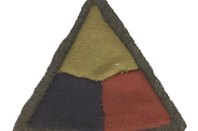 """The """"patch"""" designed for armored forces during World War I by LTC George S. Patton and his staff. This insignia belonged to Sergeant Harry E. Record, 301st Tank Battalion. The colors represent the three branches of service-blue for infantry, yellow for cavalry, and red for artillery. World War I Veterans Survey Collection, Army Heritage Museum/Army Heritage and Education Center."""