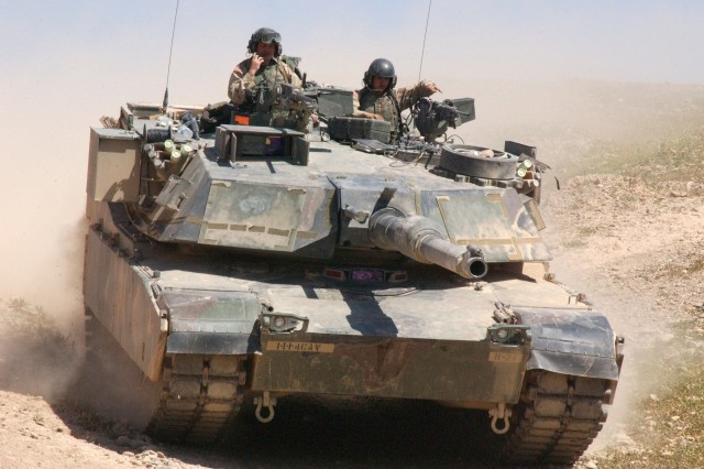Soldiers of Company B, 1st Squadron, 4th Cavalry Regiment, 1st Infantry Division, in their M1A1 Abrams tank in Iraq, April 2004. Source: Photo by Pvt. Brandi Marshall.