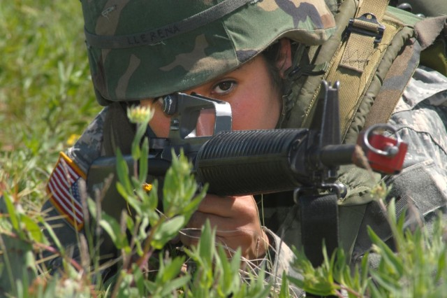 Pvt. Marissa Llerena, from the 344th Military Intelligence Battalion, gets into a good shooting position during Exercise Mount City at Goodfellow Air Force Base, Texas, April 11.