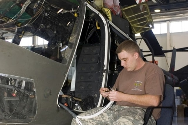 Staff Sgt. Chris Welch, from the Mississippi Army National Guard, overhauls an OH-58AC Kiowa helicopter at the 1108th Aviation Classification and Repair Depot in Gulfport, Miss.
