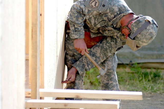 Pfc. Anthony Petersen, a carpentry and masonry specialist with the 585th Engineers Company, works on a structure to be used by Soldiers from Task Force Spartan at Jalalabad Airfield, Afghanistan.