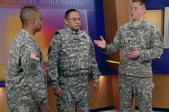 Sgt. Flores demonstrates the benefits of the new and improved Outer Tactical Vest.