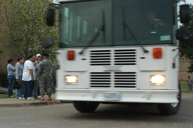 A bus loaded with Soldiers departs Fort Hood's Kieschnick Physical Fitness Center April 20 headed to Gray Army Airfield, where more than 100 Soldiers from the 1st Cavalry Division and other Fort Hood units boarded airplanes bound for Iraq.