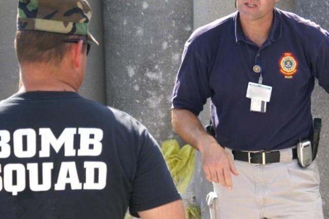 FBI Special Agent Scott Hahn explains the way to mark evidence for collection at a bombing scene to Air Force Master Sgt. James Raulerson at Homestead Air Reserve Base, Fla. Lt. Gen. Lute said organizations such as the Federal Bureau of Investigation must work to apply constant pressure on the al Qaeda network.
