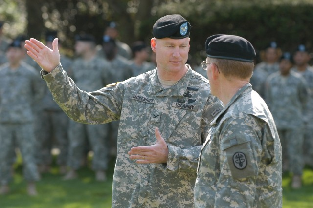 Col. Terrence McKenrick (left) Warrior Transition Brigade commander, talks with Maj. Gen. Eric B. Schoomaker, commander of North Atlantic Regional Medical Command and Walter Reed Army Medical Center, at the brigadeAca,!a,,cs activation ceremony today.