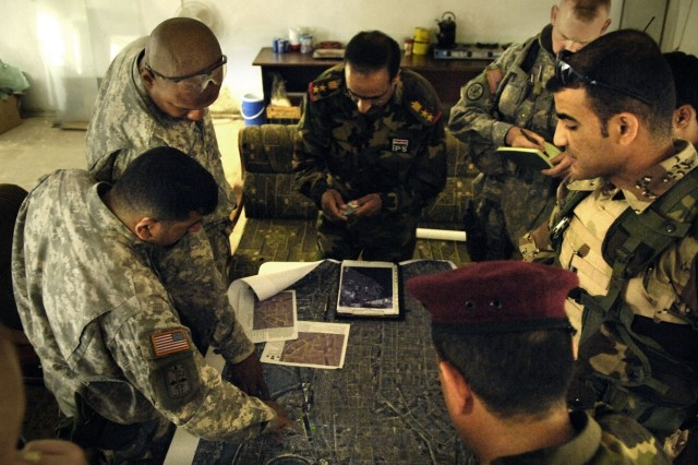 U.S. and Iraqi Soldiers and Police conduct a mission planning meeting in Baqubah.