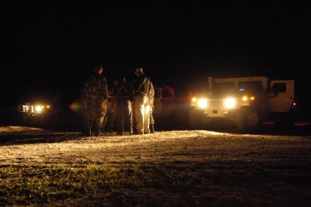Soldiers and Airmen plan their next movements during Exercise Atlantic Strike V in Avon Park, Fla. The Soldiers are with the 67th Armored Regiment.