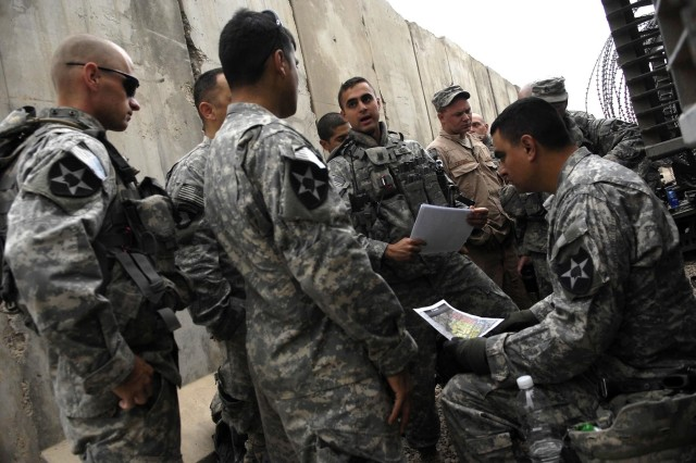 1st Lt. Grant Saxena briefs his Soldiers on the areas they will patrol during an Iraqi Army led foot patrol of Baghdad. The Soldiers are from the 3rd Stryker Brigade Combat Team, 2nd Infantry Division.