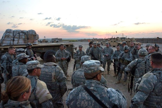 Soldiers from the 25th Infantry Division get a  mission brief before delivering a convoy of food and water to residents of Tal Afar, Iraq.