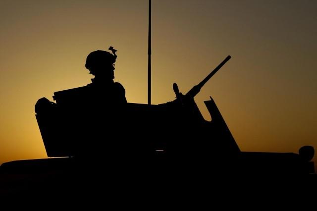 Spc. Kelly Wilson, from the 3rd Brigade Combat Team, 25th Infantry Division, patrols Al Muradia village, Iraq.