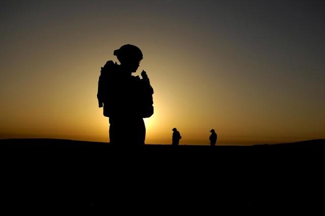 Spc. Justin Towe, from the 3rd Brigade Combat Team, 25th Infantry Division, patrols Al Muradia village, Iraq.