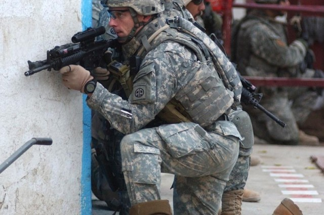Maj. Charles Massaracchia and fellow Soldiers provide security for their comrades nearby.