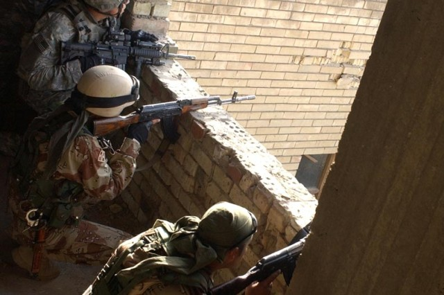 Soldiers get into a good position during the firefight.