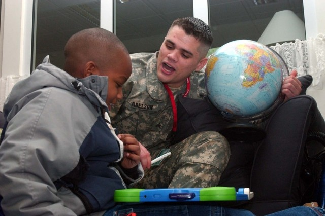 A Soldier from the U.S. Army Garrison Kaiserslautern, Germany, Better Opportunities for Single Servicemembers program participates in the Kaiserslautern American Elementary School Mentorship Program.
